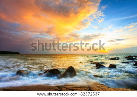 Tropical colorful sunset at the stones beach. Thailand - stock photo