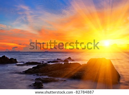 Tropical colorful sunset at the tropical beach. Thailand - stock photo