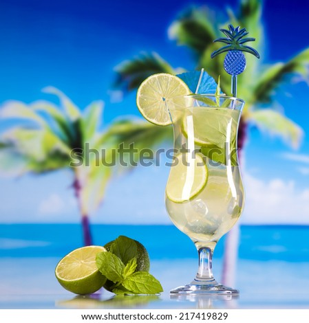 Tropical drinks on beach - stock photo