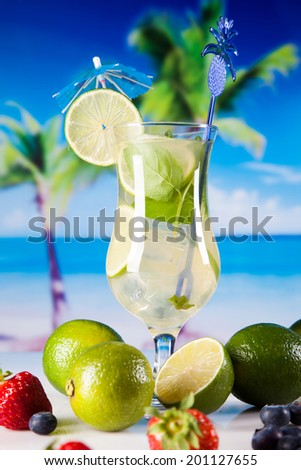 Tropical drinks on beach and sun