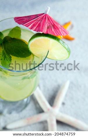 Tropical drinks on beach and sun - stock photo