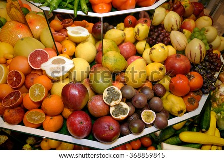 Tropical exotic fruits. Grapefruits, kumquat, mangoes, papayas, pomegranates, persimmons, grapes, passion fruit, guava, carambola, apples. Concept of healthy eating, vegetarianism, fruitarianism