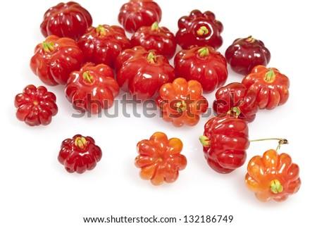 Tropical fruit also called Pitanga, Brazilian Cherry, Suriname Cherry, Cayenne Cherry - stock photo