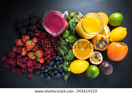Tropical fruit and berries fruit smoothies with fresh fruits, diet concept - stock photo