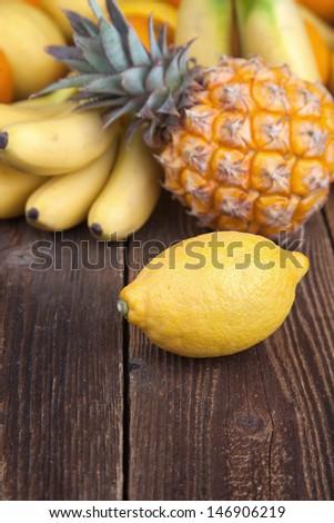 Tropical fruit mix on wood I - stock photo