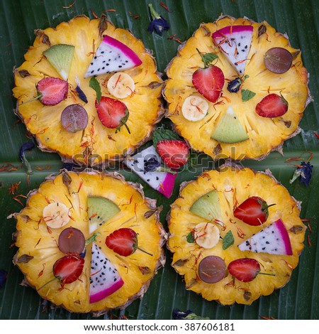 Tropical fruit pizza with pineapple, strawberry, kiwi,grapes, banana and dragon fruit. Close up - stock photo