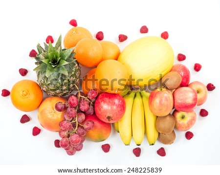 tropical fruits and berries isolated on white background