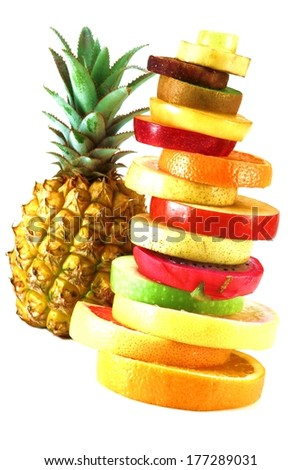 tropical fruits cut than Fruit Tower with pineapple  - stock photo