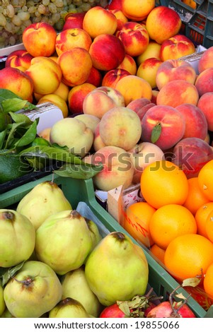 Tropical fruits: peach, oranges.