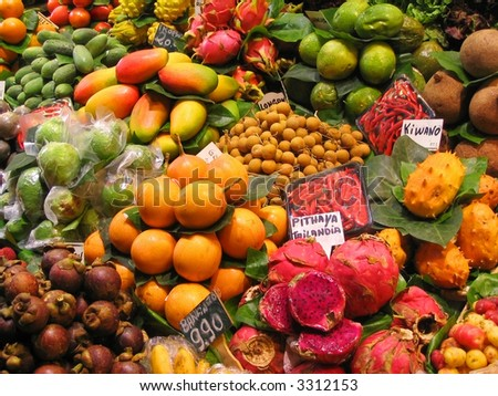 Tropical fruits stall at the market - stock photo