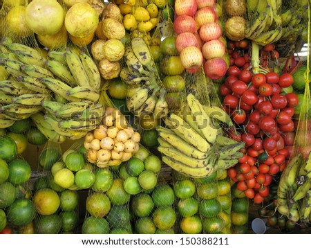 Tropical fruits, such as passion fruit, bananas, limes, guava, Bactris gasipaes, oranges. Fruit stall in Manaus, Amazonas - stock photo