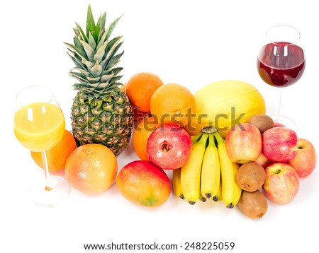 tropical fruits with fruit juices isolated on white background - stock photo