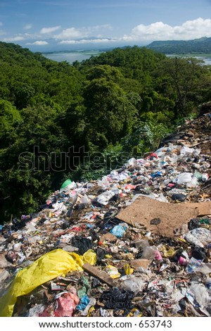 Tropical garbage dump - stock photo