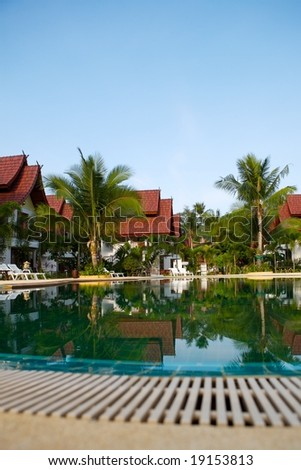 Tropical holiday resort with swimming pool in Thailand