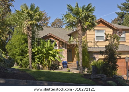 Tropical house with banana and palm trees Oregon. - stock photo