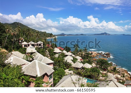 Tropical houses with beautiful sea view - stock photo