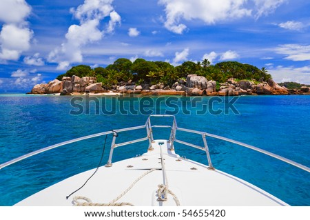 Tropical island and boat - nature background