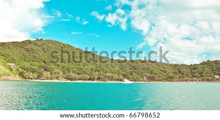 Tropical island and clear sea. Panoramic shot - stock photo