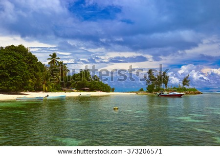 Tropical island at Seychelles and boats - nature background