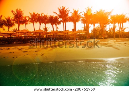 Tropical island beach view from sea side sunshine color effect photo - stock photo