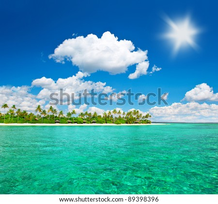 tropical island beach with cloudy blue sky. island of maldives