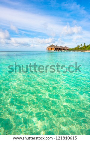 Tropical island beautiful landscape with emerald water, green trees and blue sky