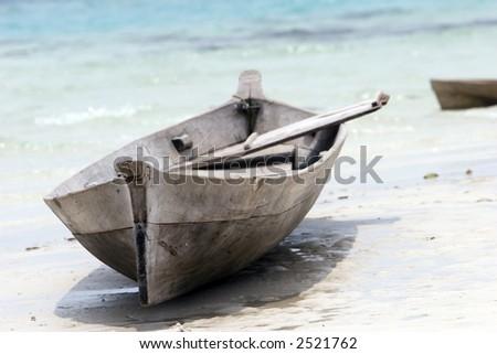 Tropical island,canoe - stock photo