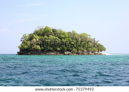 Tropical island in the ocean with blue sky background, krabi , Thailand