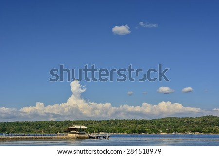Tropical island jetty in Southern Philippines against clear blue sky - stock photo
