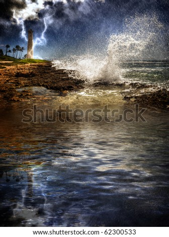 Tropical Island Storm. Rain and lightning reflected in the sea, lighthouse in the distance along a rocky coast. Barber's Point, Oahu Hawaii 2009. - stock photo