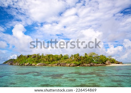 Tropical island with palms and sand beach, Seychelles - stock photo