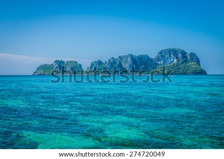 Tropical island with resorts - Phi-Phi island, Krabi Province, Thailand. - stock photo