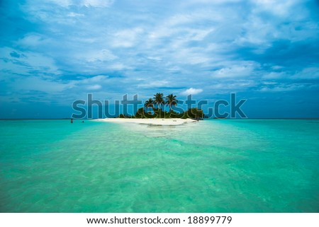 Tropical island with white sand beach - stock photo