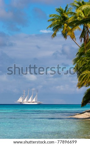 Tropical island with white ship in the background, Fakavara,  French Polynesia