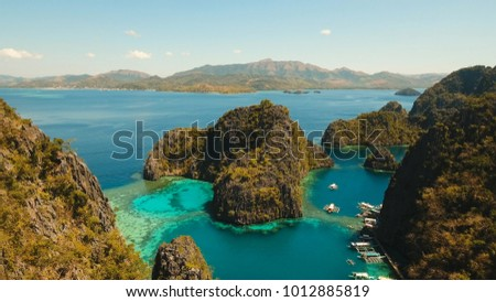 Tropical lagoon with azure water, beach by the Kayangan Lake, Philippines. Aerial view Coron island, with cove, bay at Kayangan lake. Lagoon with sailing boats. Aerial video. Philippines. Travel