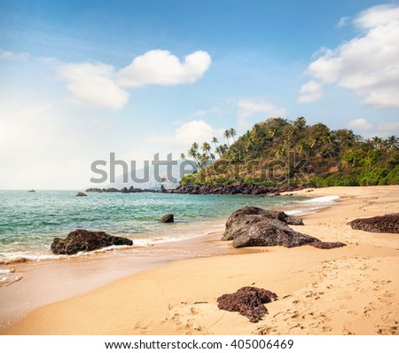 Tropical lagoon with ocean at sunny in Cola beach in Goa, India