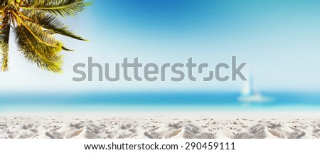 Tropical landscape with coconut palm tree, white sand beach and blurry ocean. Design banner background. Panoramic view. - stock photo