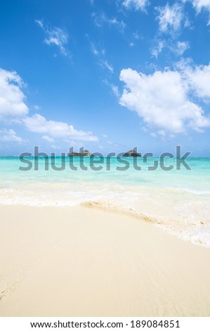 tropical Lanikai beach in Oahu Hawaii with two islands - stock photo