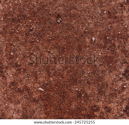 Tropical laterite soil or red earth background. Red mars seamless sand background. Top view - stock photo