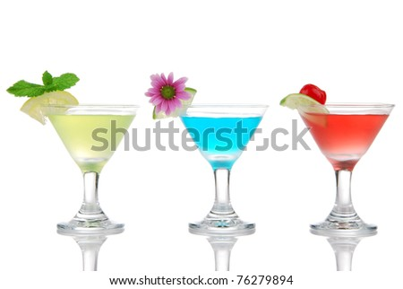Tropical martini Cocktails row with vodka, light rum, gin, tequila, blue curacao, lime juice, lemonade, lemon slice and fresh summer flowers in martinis cocktail glass on a white background - stock photo