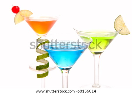 Tropical martini Cocktails with vodka, light rum, gin, tequila, blue curacao, lime juice, lemonade, lemon slice, maraschino cherry isolated on a white background - stock photo