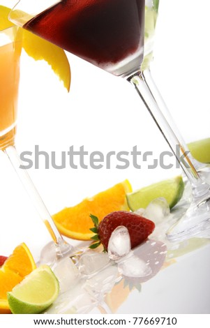 Tropical Martini drinks with fruits on white background - stock photo
