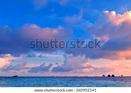 Tropical morning seascape of the fresh blue sea water, blue sky and clouds in Maldives. - stock photo