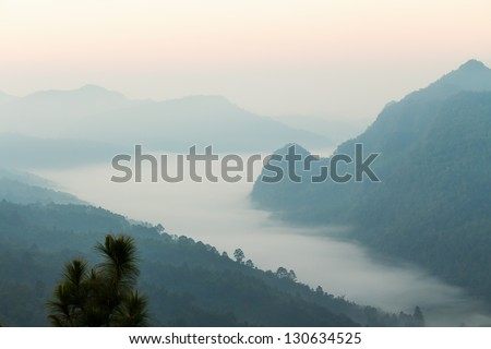 Tropical mountain ranges in the mist at dawn, northern Thailand - stock photo