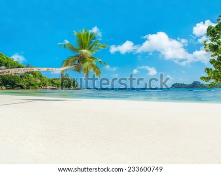 Tropical ocean beach Baie Lazare with boat, Mahe island, Seychelles - vacation background - stock photo