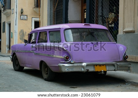 Tropical oldtimer parked in the streets of Havana - stock photo