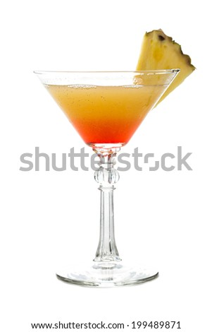 Tropical orange cocktail in martini glass garnished with pineapple isolated on white background - stock photo