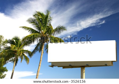 Tropical palm trees and a billboard in the late afternoon sun. The golden hour. Advertise your holiday specials!
