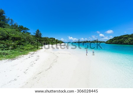Tropical paradise beach and clear blue lagoon water, Kabira Bay, Iriomote-Ishigaki National Park of the Yaeyama Islands, Okinawa, Japan - stock photo