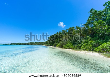 Tropical paradise beach with clear blue lagoon water, Ishigaki Island National Park of the Yaeyama Islands, Okinawa, Japan - stock photo